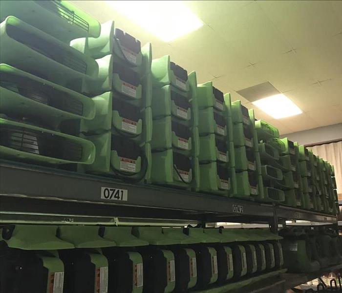 Air Movers stacked on shelving