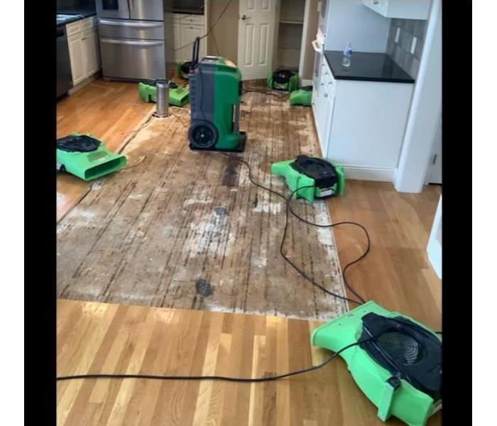 equipment set on removed hardwood flooring