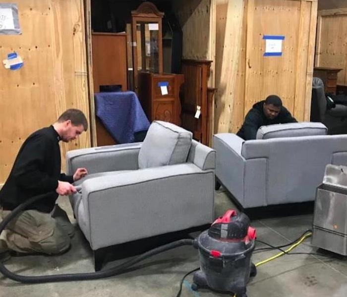 technicians cleaning furniture affected by a fire